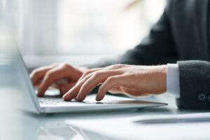hands of contemporary mobile broker pushing keys o 63GAC9H | Business Communications | Business IT Port Elizabeth